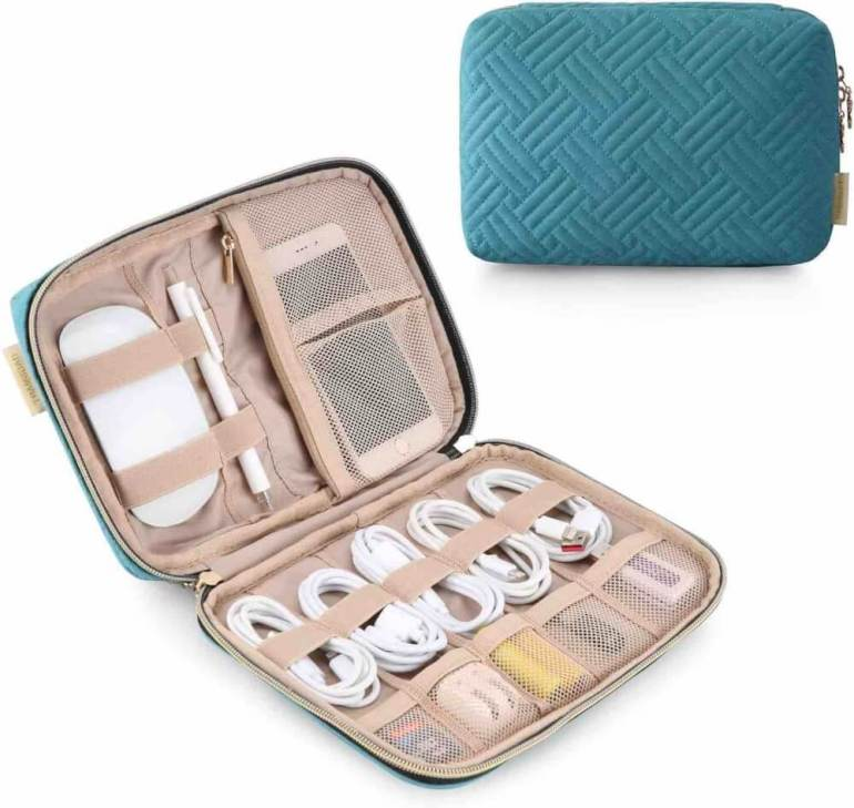 Add this electronic organizer to your Hawaii packing list to keep all your charging cables organized. Image of a blue and rose gold electronic organizer pouch.