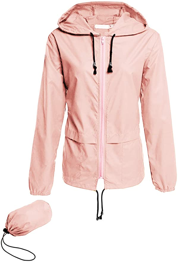 Add this packable rain jacket to your Hawaii packing list. Image of a light pink rain jacket that fits into a little pouch.