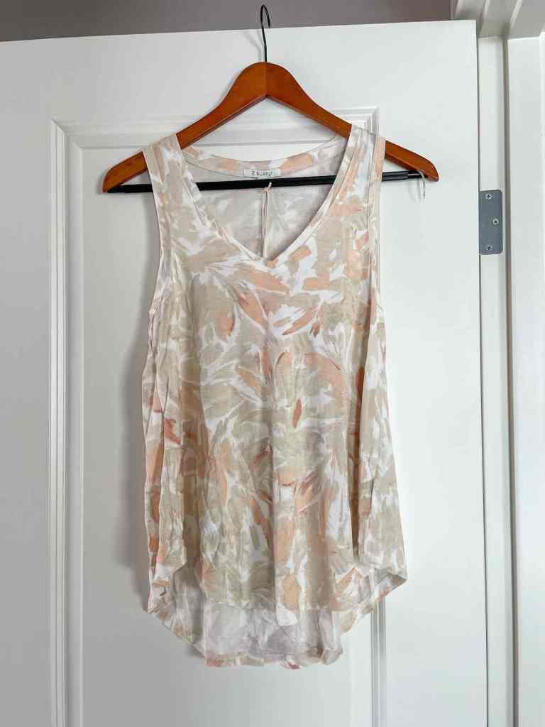 You'll definitely want to add some tank tops to your packing list for Hawaii. Image of a tan and orange tank top.