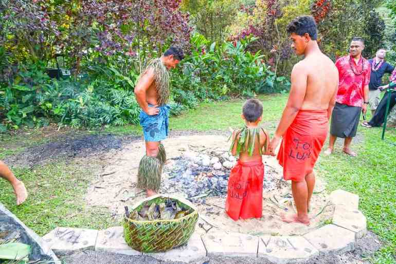 Most luaus on Oahu don't have as many hands on activities like Toa Luau in North Shore Oahu. Image of some men standing around a Samoan Umu oven ready to dig up the food.