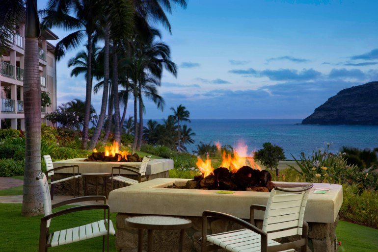 Marriott's Kauai Lagoons is one of the best resorts in Kauai for families who love a central location. Image of a fire pit overlooking the ocean.