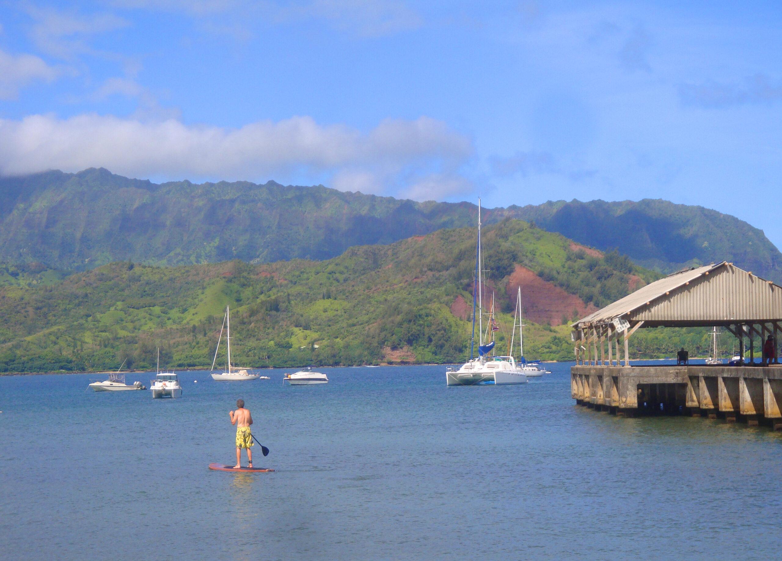 Stand up paddling near Hanalei Bay Pier