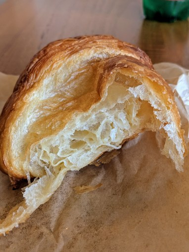 A picture of a croissant from Knots Coffee Roasters in Waikiki Hawaii