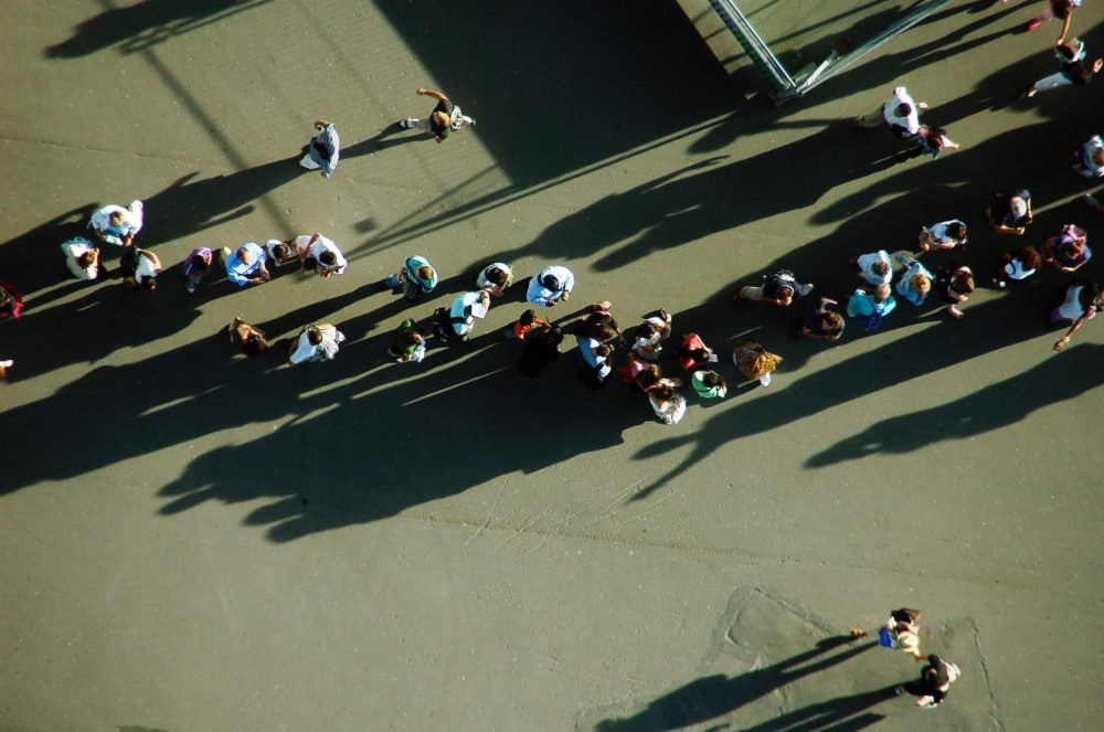 line of people outside from aerial view