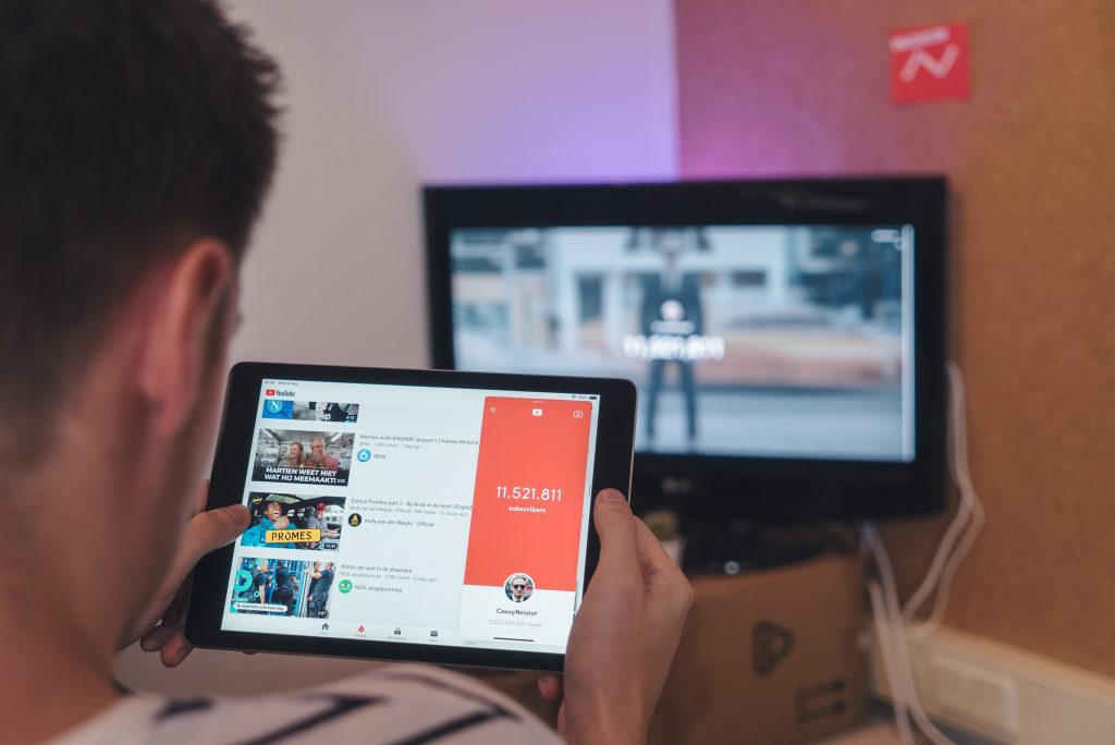 man looking at youtube on tablet