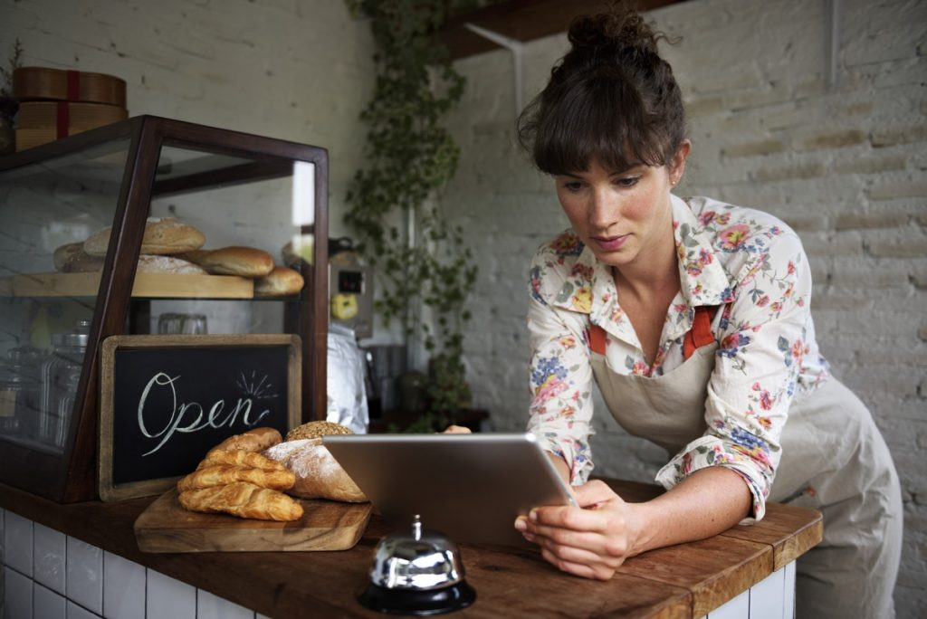 woman on a tablet updating google my business page