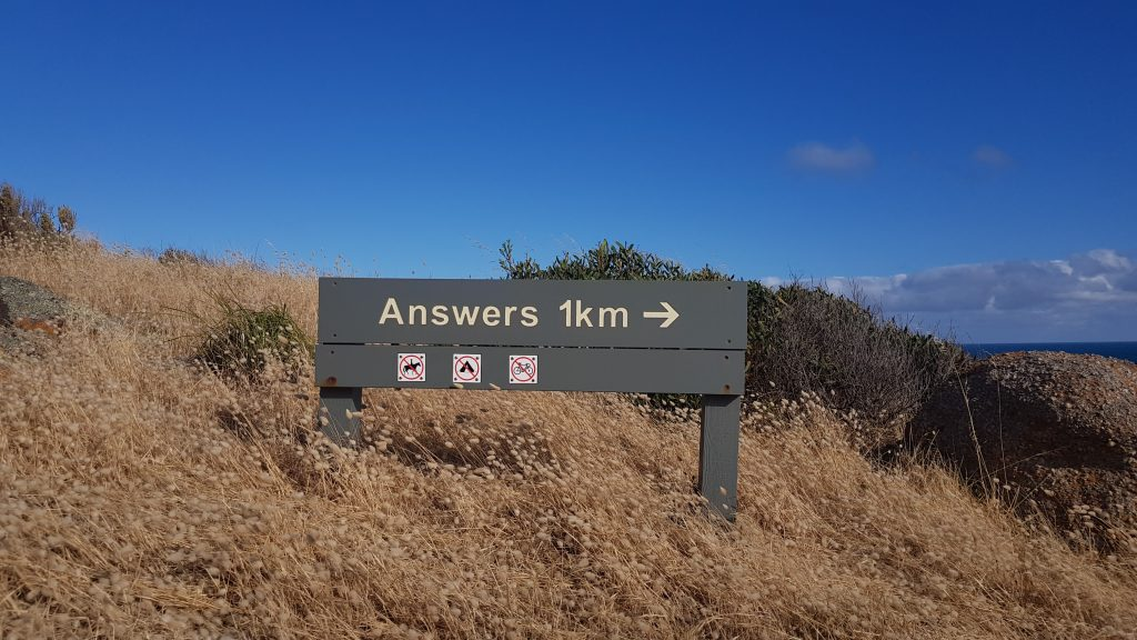 """mountain with a sign that says """"answers"""""""