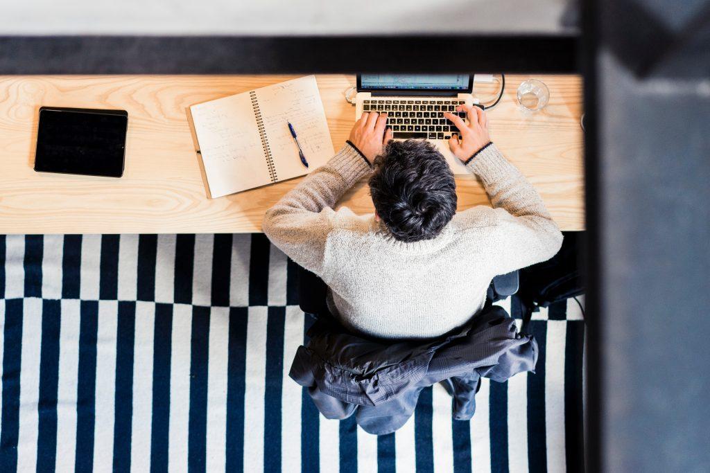 man working on saas website