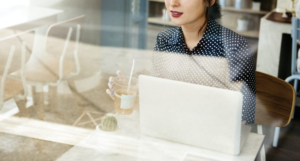 woman at computer with coffee