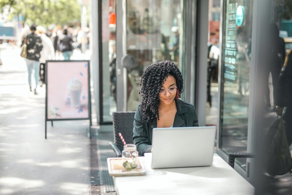 woman sitting outside with a laptop