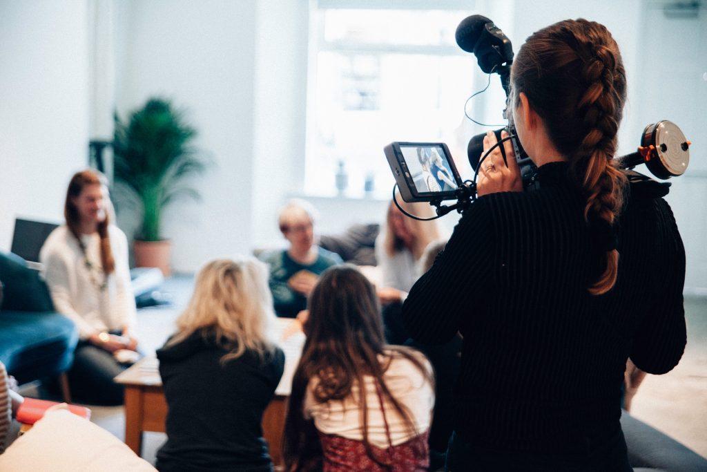 women videotaping a group of women