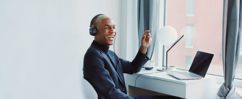 man working remotely on the phone laughing