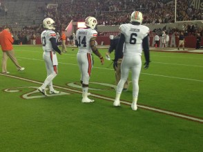 Auburn quarterbacks have to get close to each other to have a conversation in the raucous pre-game crowd for the 2014 Iron Bowl.