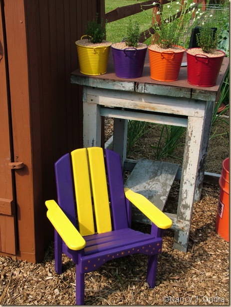 Painted Pots and chair in Happy Garden