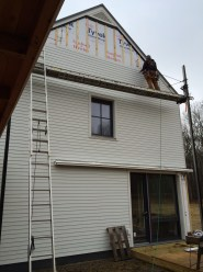 Siding is finally being completed.