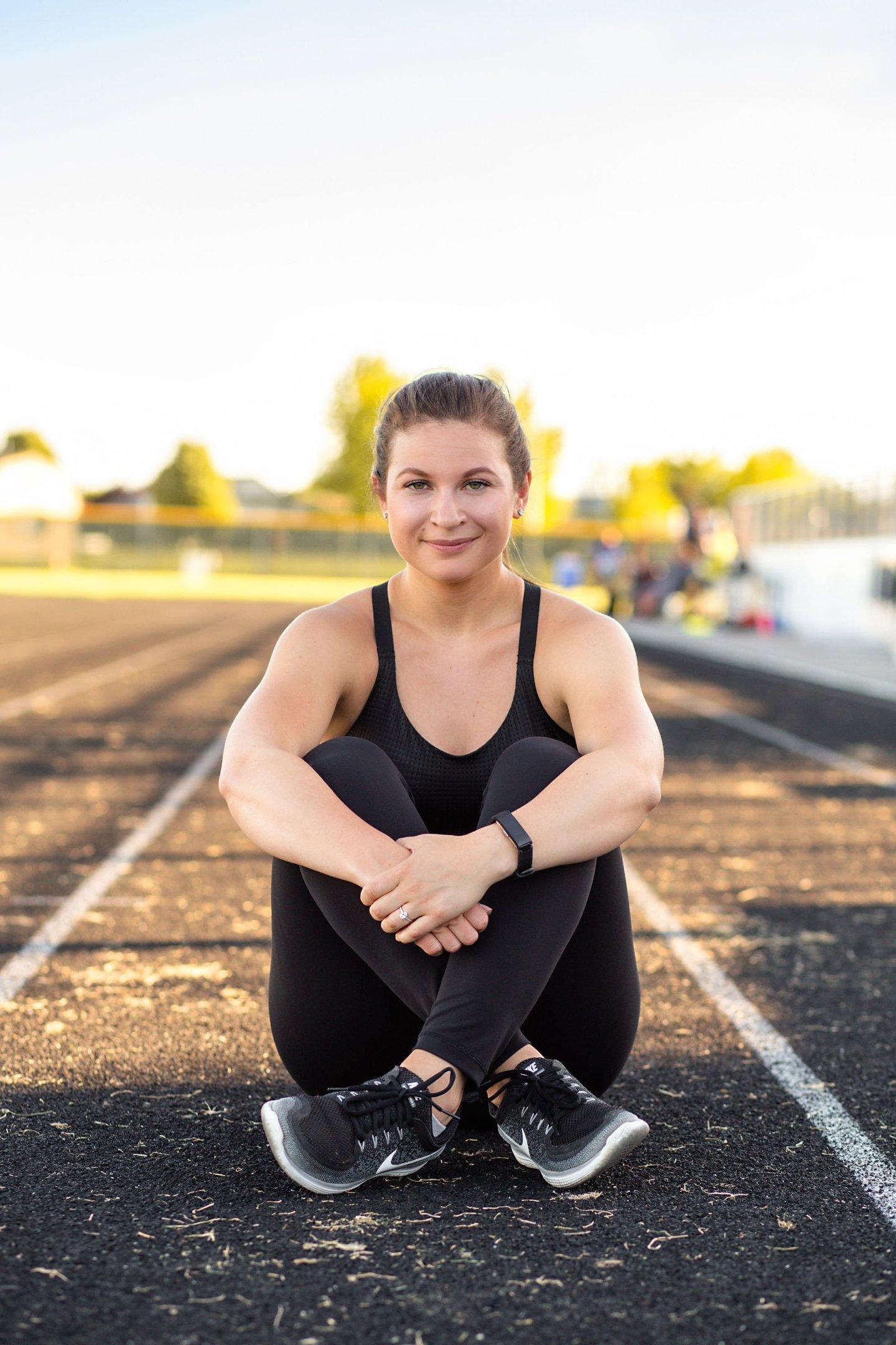 Hayle sitting on a track cross-legged