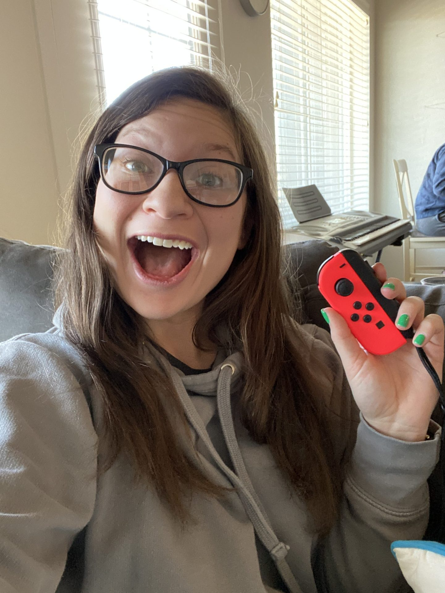 Hayle Santella Playing Nintendo Switch while self-isolating