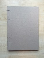 The front cover of my book made out of recycled grey board