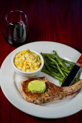 12 oz Tomahawk Pork Chop at Hay City Store & Ice House