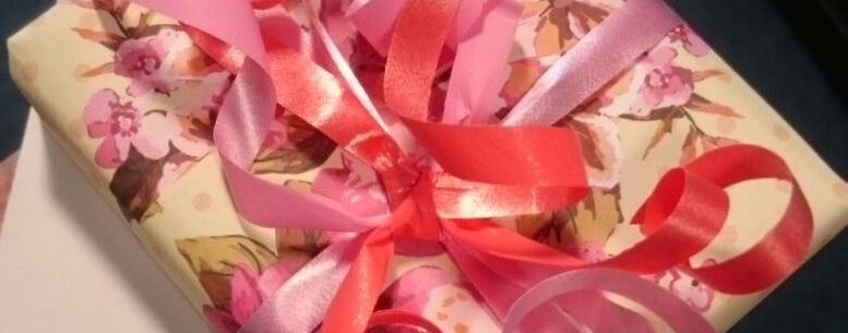 Flowery paper wrapping + pink ribbon cropped