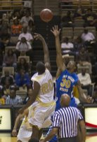 ASU's K.D. Washington drives along the baseline as Fort Valley's Cory Hunter guards him during action between Alabama State University and Fort Valley State University, November 7, 2011.Photo courtesy David Campbell/ASU
