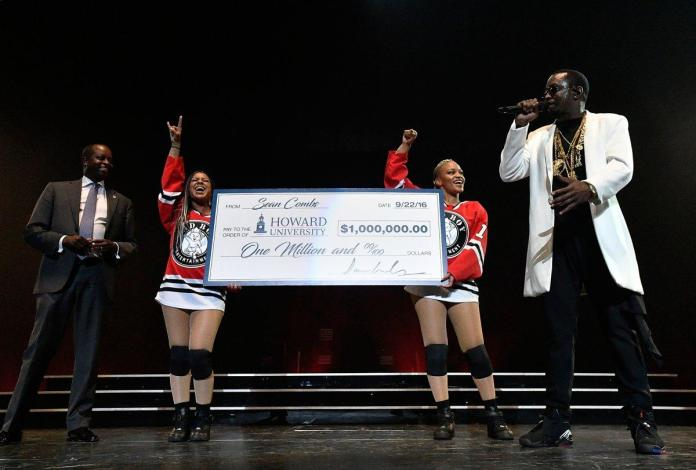 """Sean """"Diddy"""" Combs (R) presents his Alma Matter Howard University's President Wayne A.I. Frederick, M.D., MBA with one million dollar check at the Puff Daddy and Bad Boy Family Reunion Tour at the Verizon Center on September 22, 2016 in Washington D.C. (LARRY FRENCH/GETTY IMAGES FOR LIVE NATION)"""