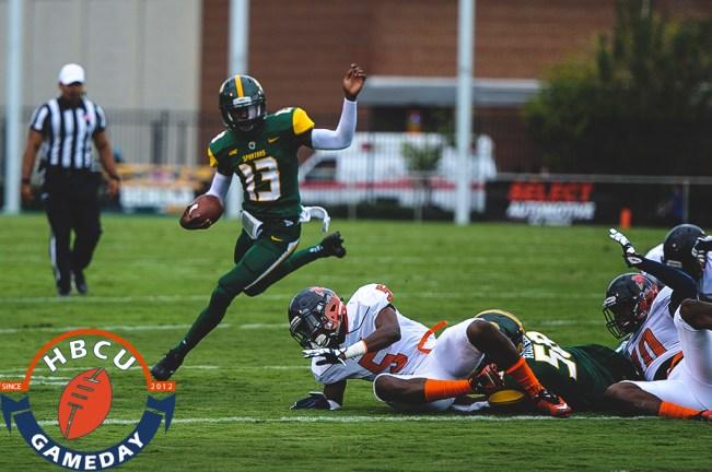 Tripp Harrington runs past VSU defenders. (Photo by Michael Peele.)