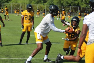 Amir Hall hands off to a RB