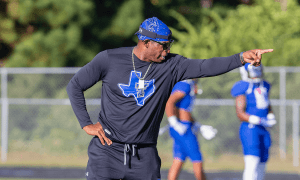 Deion Sanders on the sidelines coaching High School