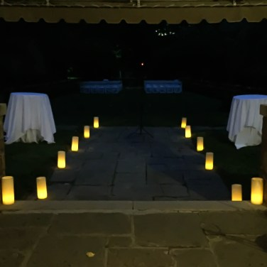 Candle decorations in outdoor wedding reception at night
