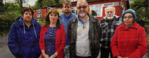 Local residents with parish councilior John Moore, centre, at the site of the proposed hall in School Lane