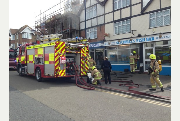 Firefighters outside the fish bar. Picture: Matthew Wheeler