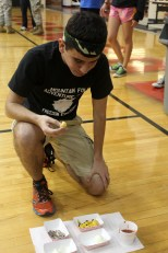 Junior David Hardy eats the two boiled eggs during the Food Relay.