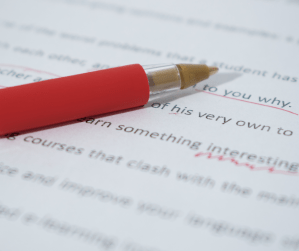Red pen on manuscript making corrections