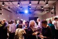 Many people at reception at HB Studio, provider of acting classes in NYC