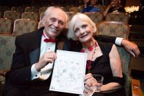 David and Britt Cryer with a sketch of themselves at 90th birthday celebration for Helen Gallagher, HB Studio teacher of Singing for the Musical Theater