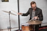 A man plays the drums at benefit for HB Studio, provider of NYC acting classes