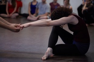 A Student at HB Studio stretches