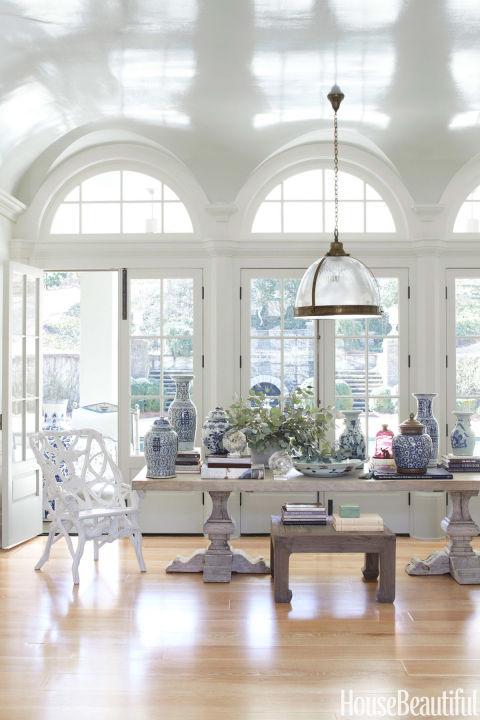 In the living room of an Atlanta house by designer Beth Webb, an elm plank table from Clubcu, which often doubles as a dining table, dramatically displays a collection of Chinese porcelains.