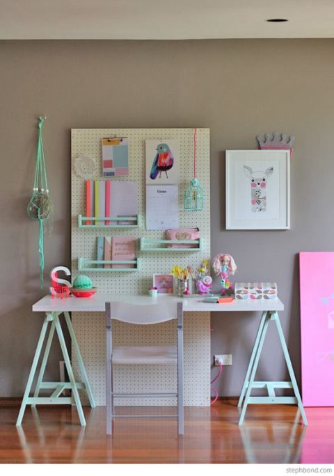 Blogger Petit & Small created this pastel-toned study space for her friend's daughter using a pegboard with tons of small details — check out the hanging calendar and caged lightbulb! MORE DIY: Brit Morin Talks DIY, Tech, and Following Your Passions