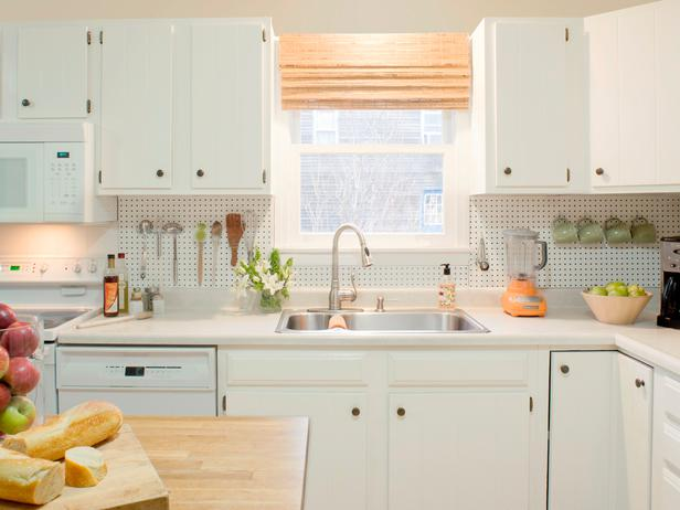Looking for a budget backsplash? Not only does pegboard look stunning, but it provides so many opportunities for sneaky storage — keep your coffee cups and cooking tools off the counter! Find the full instructions at the DIY Network. MORE DIY: Blogger Sneak Peek: Fabric-Covered Trays