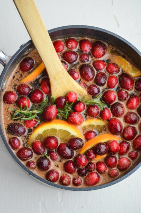 Smell goes a long way towards setting an atmosphere, and filling your home with holiday scents can make it seem like you've decorated — even if you didn't. This recipe for a cranberry and cinnamon stovetop potpourri from Rachel Schultz will make your home smell like Christmas all season long.