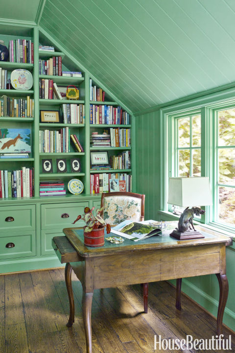 Bill Brockschmidt and Courtney Colema designed this study to look like a garden shed. Like the millwork throughout the Alabama house, it was painted in Farrow & Ball's Arsenic — a fresh green hue — to contrast with the more traditional architecture. The client's desk chair was re-covered in Lee Jofa's Althea Linen.