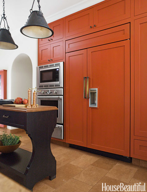 Painted Kitchen Cabinets Cabinetry Color Colorful Burnt Orange Paneled Fridge Refrigerator Wall Oven Microwave Combo Combination Black Island Pendant Light Tile Floor Shaker
