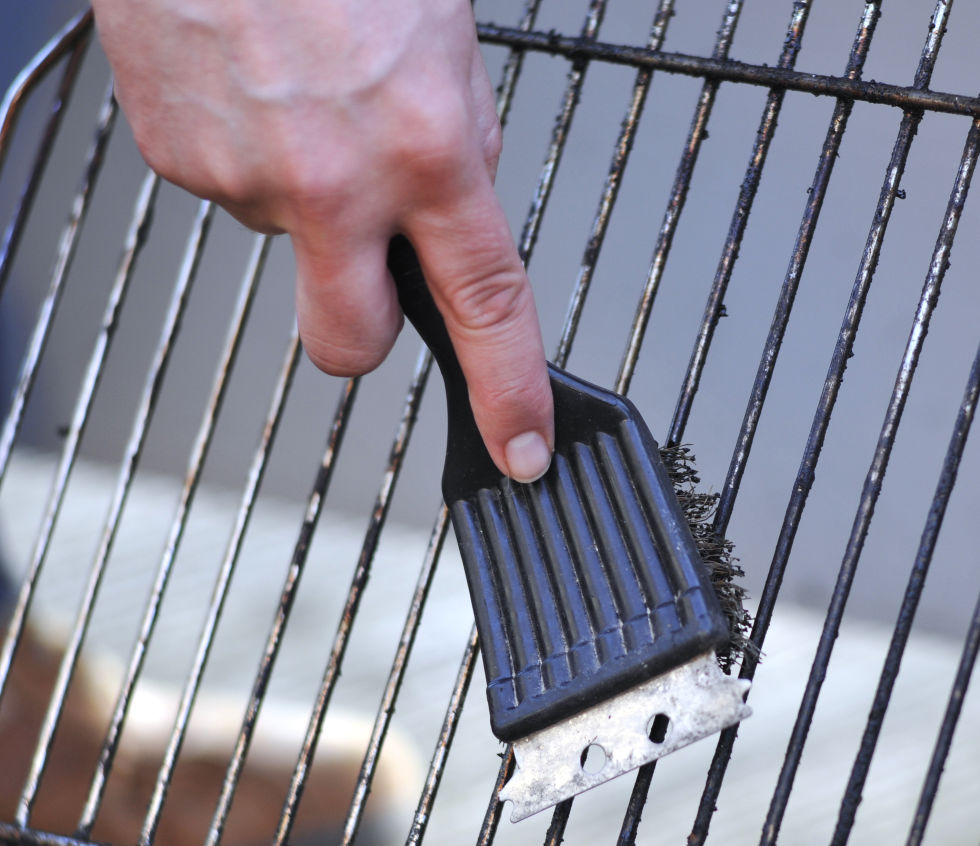 """While the grill is still warm, use a wire brush to scrub down the grates,"" advises Jolie Kerr, author of the online column Ask a Clean Person and an equally charming book. ""If you're dealing with major mess, take the grate off the grill, and use oven cleaner to attack the stuck-on food and grime. Just make sure to do this in a well-ventilated area, wearing rubber gloves to protect any exposed skin."""