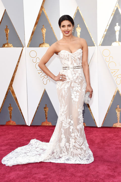 "Priyanka Chopra stunned in an intricately embroidered mermaid silhouette by Zuhair Murad with an illusion skirt at the 88th Annual Academy Awards. Get the Look: Zuhair Murad ""Petra"" bridal gown, $14,405, Mark Ingram Atelier, 212.319.6778."