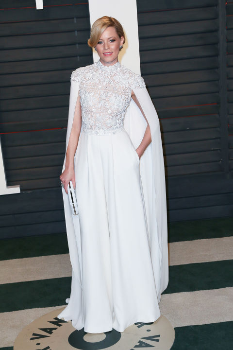Take note of cool ways to cover up: Elizabeth Banks watched the Oscars awards ceremony from the Vanity Fair party in a caped mock-necked Ralph & Russo embellished gown.