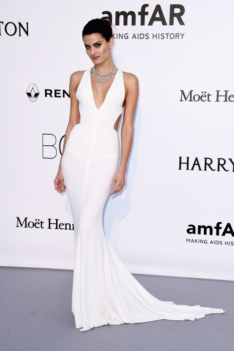 "Isabeli Fontana turned heads on the carpet at amfAR's 23rd Cinema Against AIDS Gala at the Cannes Film Festival, accenting her uber-minimalist fishtail gown with a jaw-dropping diamond collar.  Get the Look: Vera Wang Bride ""Priscilla"" sheath, price upon request, verawang.com."