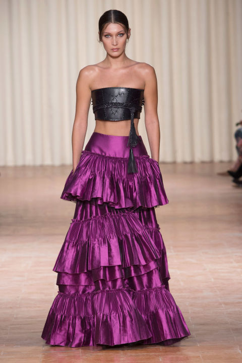 How do you sell an evening look featuring a leather obi-style belt as the top and a magenta ruffled flamenco skirt? Put a Hadid in it. Bella opened Alberta Ferretti's show looking drop-dead in said unexpected combination that, let's be honest, you need to have Hadid-ish proportions to pull off. But then again, Ferretti has always been of the red carpet mind.