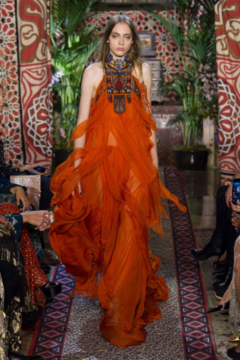 """A sheer tangerine gown in ruffles and wisps instantly conjured images of Beyonce in the yellow Cavalli dress bashing her way through """"Lemonade,"""" when she basically anointed Dundas' vision of the now iconic house, where he's still relatively new."""
